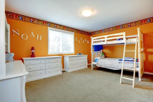 Bright orange boys room with bulk bed